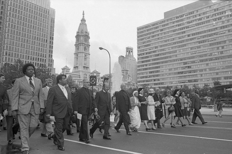 The Pilgrimage of Hope procession moves through center city Philadelphia in June 1974 with Mother Teresa participating, along with Auxiliary Bishop of Philadelphia John Graham (to her left) and other religious and civic leaders of the time. (Philadelphia Archdiocesan Historical Research Center, Robert and Theresa Halvey Photograph Collection)