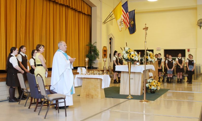 Msgr. Philip Cribben celebrates the opening liturgy of the 75th anniversary year Sept. 12 at St. Hubert''s Catholic High School for Girls. (Sarah Webb)