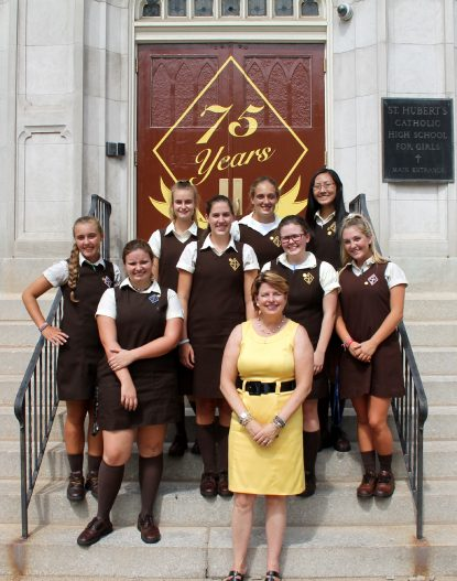 President Lizanne Pando poses with St. Hubert's students at the archdiocesan high school. (Sarah Webb)
