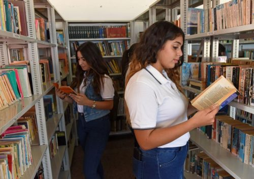 Students look at books in the library Sept. 8 in the Nazareth Sisters school in Haifa, Israel. (CNS photo/Debbie Hill)