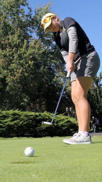 Archbishop Wood standout golfer Karly Brown practices her winning putting stroke on the practice green. (Photo by Sarah Webb)