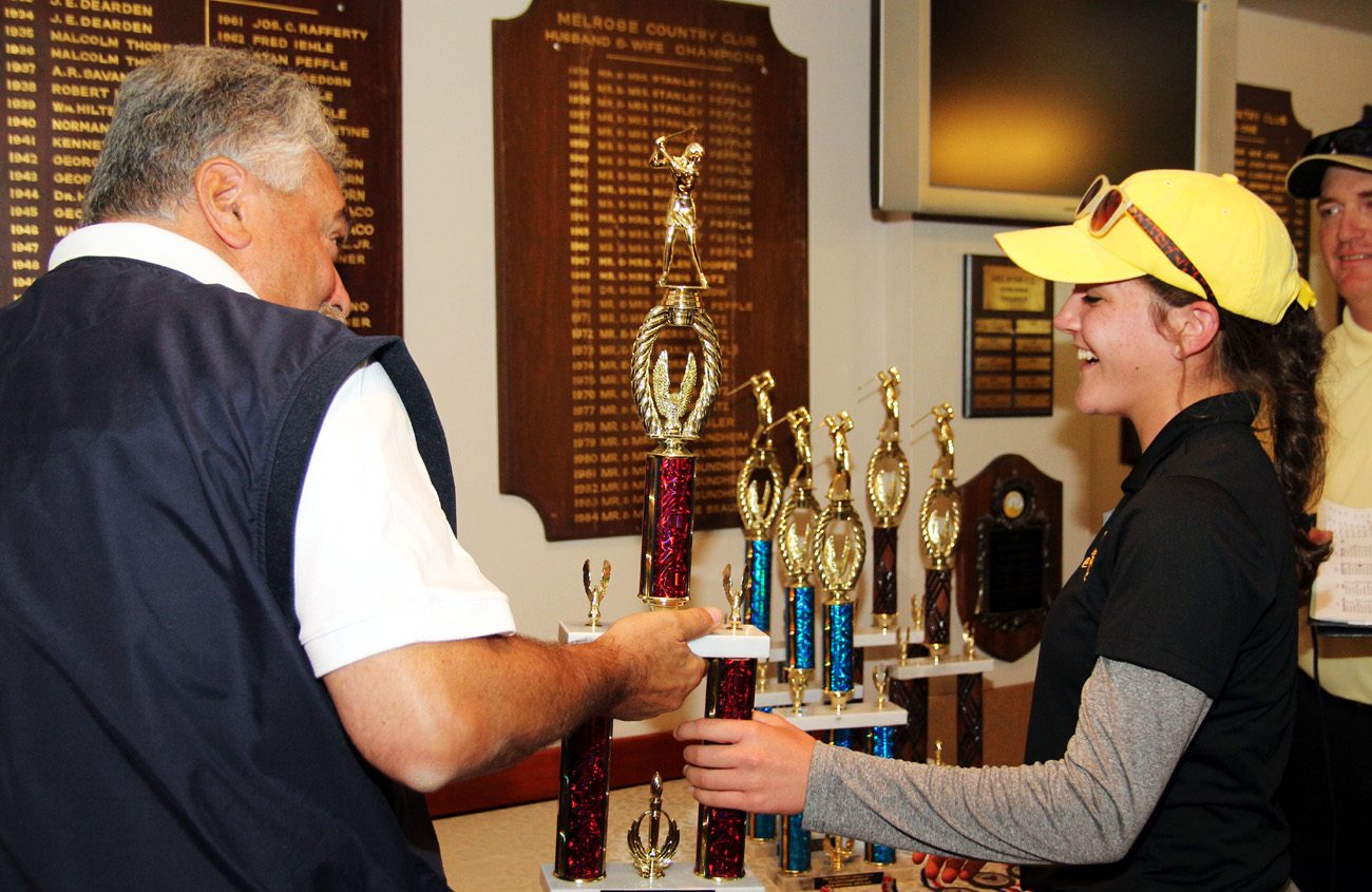 Joe Sette, athletic director for Archbishop Wood High School, presents Karly Brown a trophy as the top golfer of the Catholic League in 2015. (Sarah Webb)