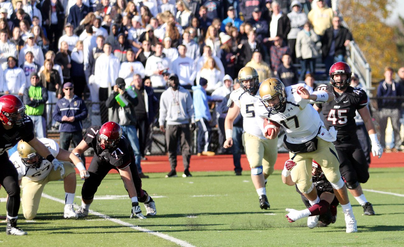 St. Joseph's Prep player James Johnson tackles La Salle quarterback Christopher Ferguson during the 2015 Catholic League championship game in which La Salle prevailed. (Photo by Sarah Webb)