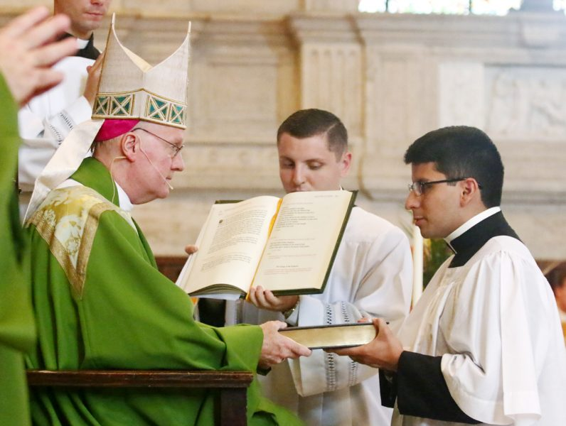 Marco Casanova is instituted into the ministry of lectors by Bishop Michael Fitzgerald.