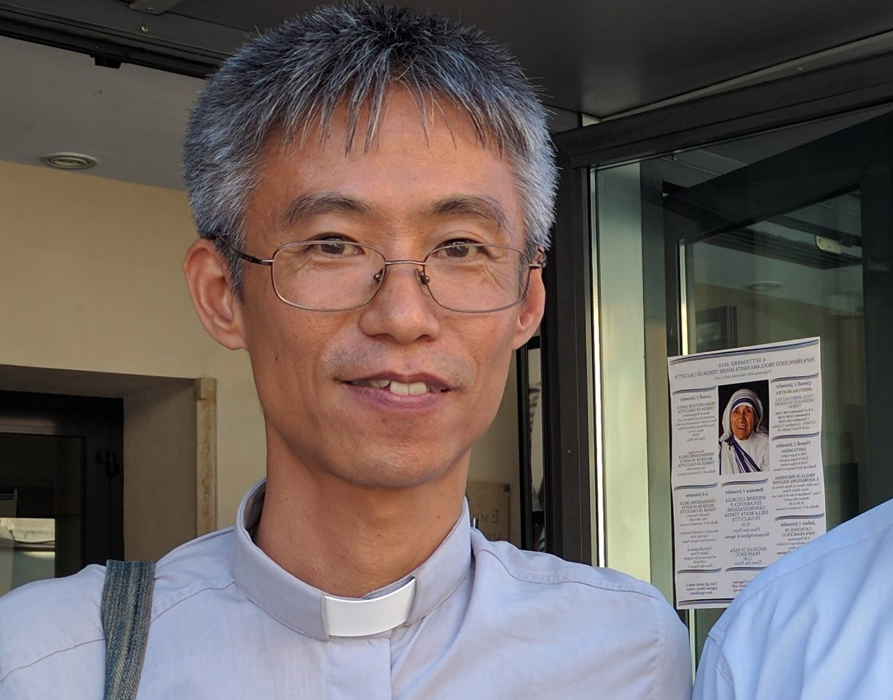 Missionaries of Charity Father Francisco Akihiro from Japan is pictured outside an exhibit on Blessed Teresa of Kolkata in Rome Sept. 2. A personal encounter with Mother Teresa led Father Akihiro to become Catholic and eventually a priest. He was born into a Buddhist family and said he didn't know the name of Jesus. (CNS photo/Junno Arocho Esteves)