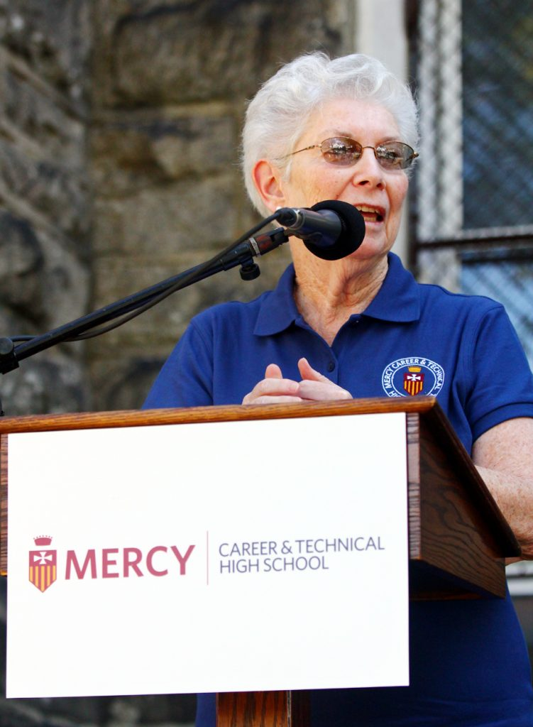 Sister Rosemary Herron, R.S.M., president of Mercy Career and Technical High School, announces the new name of the school.