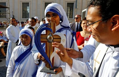 A Missionaries of Charity nun carries a relic of St. Teresa of Kolkata before Pope Francis celebrates her canonization Mass in St. Peter's Square at the Vatican Sept. 4. (CNS photo/Stefano Rellandini, Reuters)