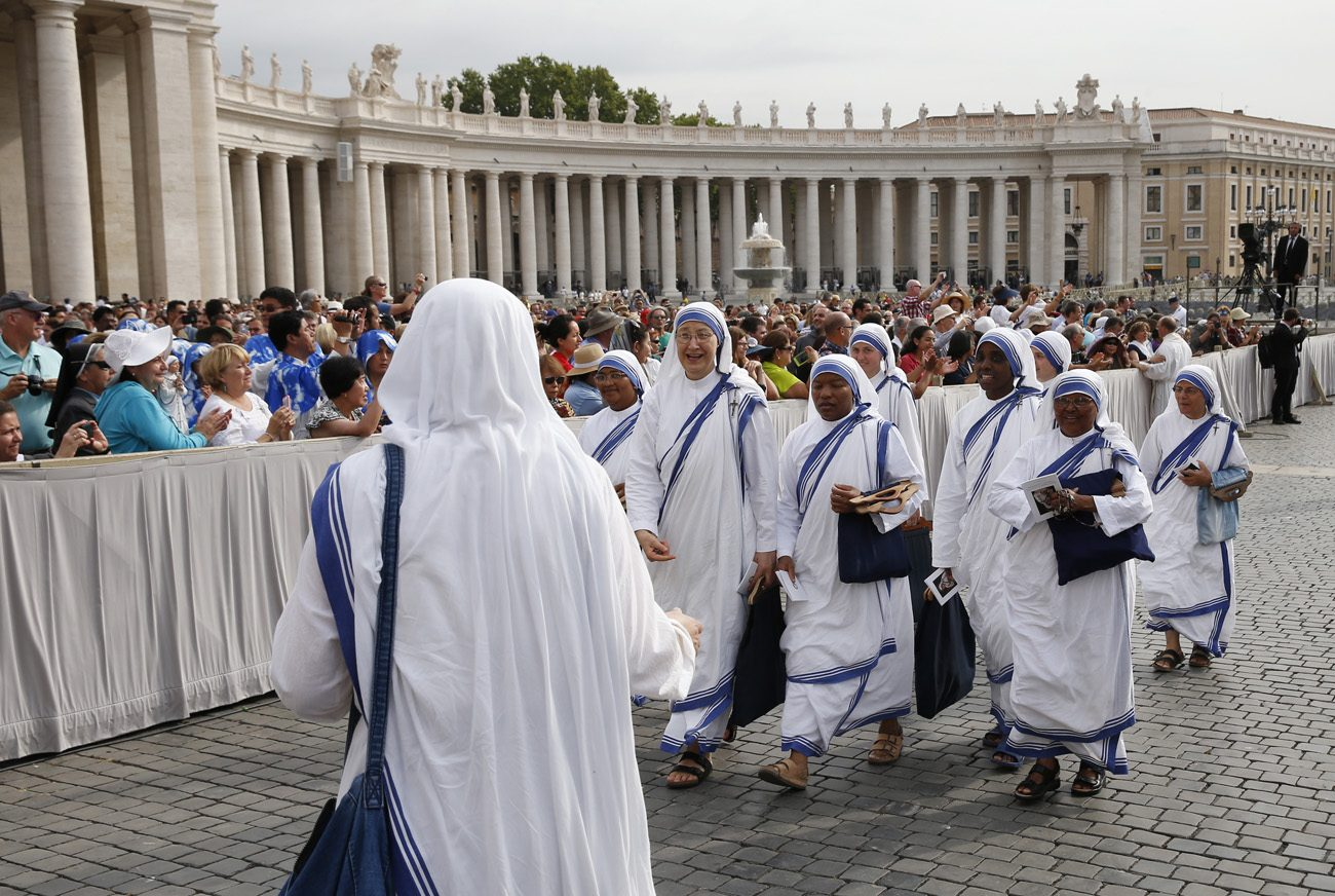 Missionaries of Charity nuns arrive for a Mass of thanksgiving for the canonization of St. Teresa of Kolkata in St. Peter's Square at the Vatican Sept. 5. The Mass was celebrated by Cardinal Pietro Parolin, Vatican secretary of state. (CNS photo/Paul Haring)