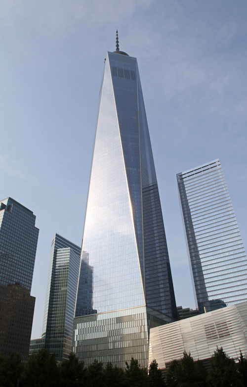 The 1,776-foot tall One World Trade Center is seen in New York City Sept. 3. The structures overlook the 9/11 Memorial and Museum. Pope Francis will visit the memorial and participate in an interreligious prayer service inside its museum, lower right, Sept. 25. (CNS photo/Gregory A. Shemitz)