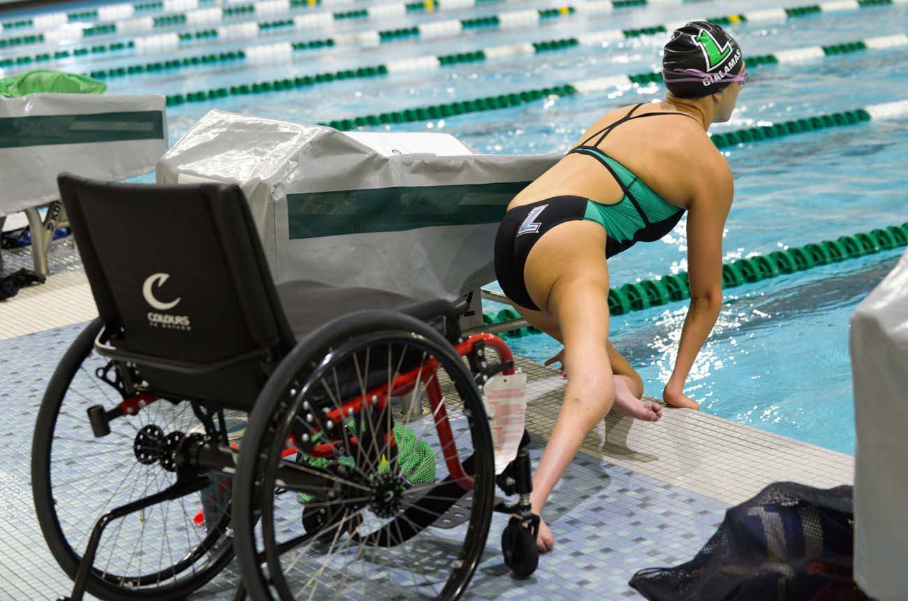 Alyssa Gialamas, a Loyola University Maryland junior and Paralympian, prepares for one of many laps Aug. 10 as a member of the USA Paralympic swimming team at the university in Baltimore. Gialamas is competing at the 2016 Paralympic Games in Rio de Janeiro. (CNS photo/Kevin J. Parks, Catholic Review)