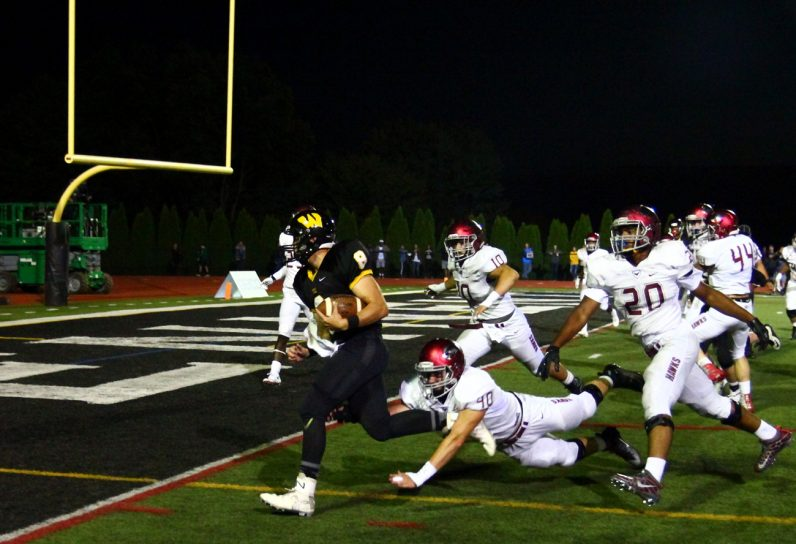 Wood's George Mazzacano scores a touchdown with several Prep players on his heels.