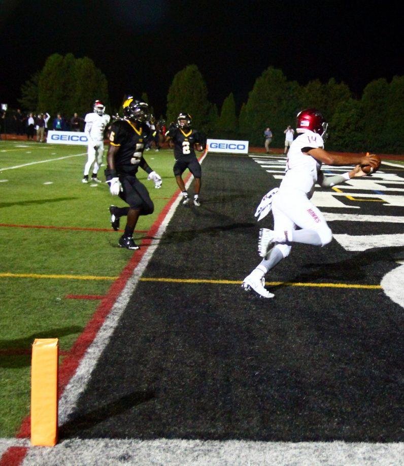 Prep quarterback Marquez McCray scores a touchdown.