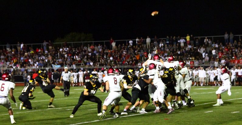 Wood's Dan Zanine's  field goal soars through the uprights for a score.