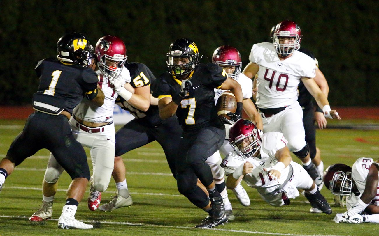 Archbishop Wood senior running back Shawn Thompson breaks through a hole for a gain. (Sarah Webb)