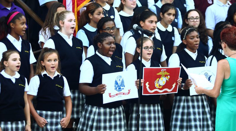 Students from St. Francis Xavier School Choir sing a medley of patriotic songs at the rally.