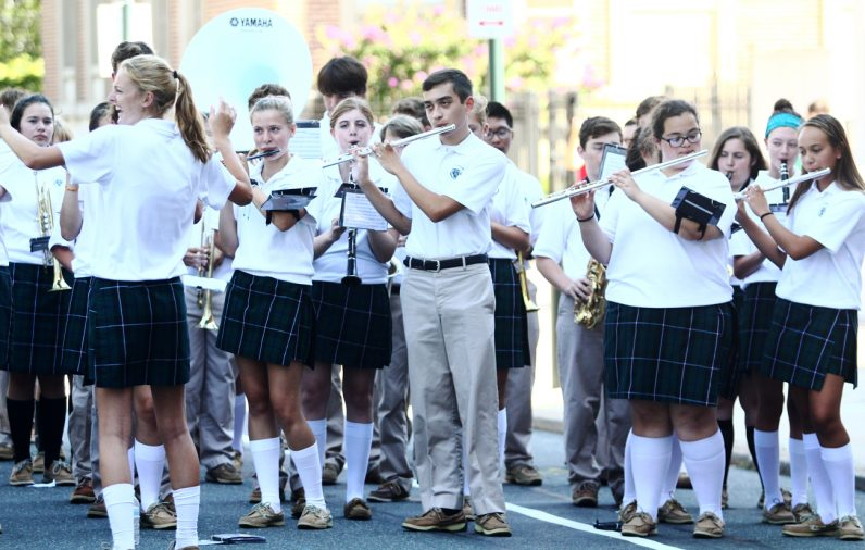 Bishop Shanahan High School's Jazz Pep Band entertains the crowd on 18th Street in front of the cathedral.