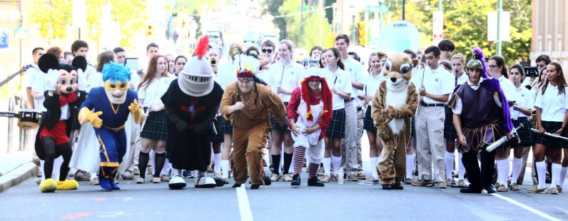 Mascots from seven archdiocesan high schools race to the finish line and the prize of a dress-down day for their school.