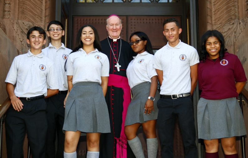 Bishop Michael Fitzgerald greets students from Mercy Vocational High School.