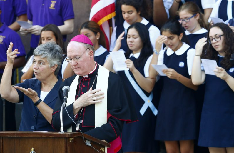 Bishop Fitzgerald leads students in prayer during the back-to-school pep rally on the steps of the cathedral in Center City Philadelphia.