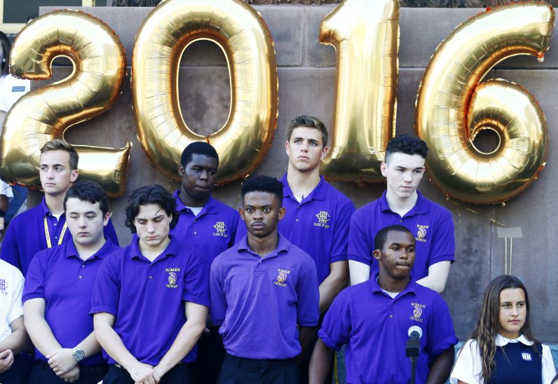 Balloons signifing the beginning of the 2016-2017 school year fly above young men from Roman Catholic High School.
