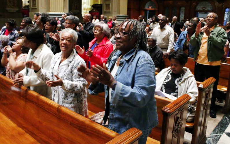 Catholic faithful raise their hearts and voices in prayer and praise at the Sept. 26-27 revival sponsored by the archdiocesan Office for Black Catholics. (Photo by Sarah Webb)