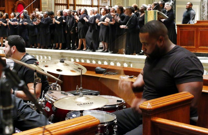 Under the direction of Kenny Arrington, the Philadelphia Mass Choir filled the church with their voices of praise.