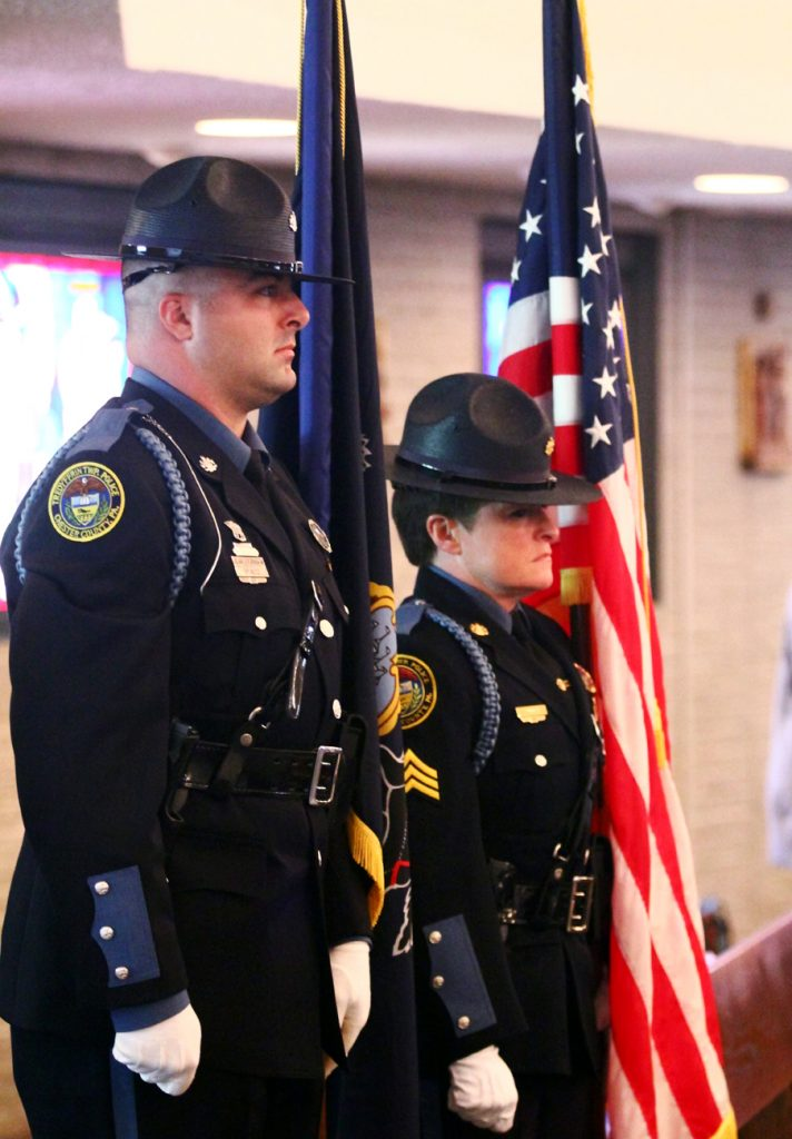 Officer Michael Spirito and Sargent Michelle Major of the Tredyffrin Police Department carry the flags in the procession of the Blue Mass at St. Isaac Jogues Church.