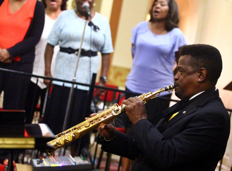 Knight Cleveland Horton adds a beautiful tone to the Mass with his soprano saxophone, as the choir leads the congregation in song.