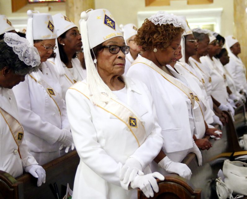 Lady Doris Watson from St. Athanasius Parish in West Oak Lane, Philadelphia, attends the Mass for St. Peter Claver along with fellow Ladies Auxiliary members.