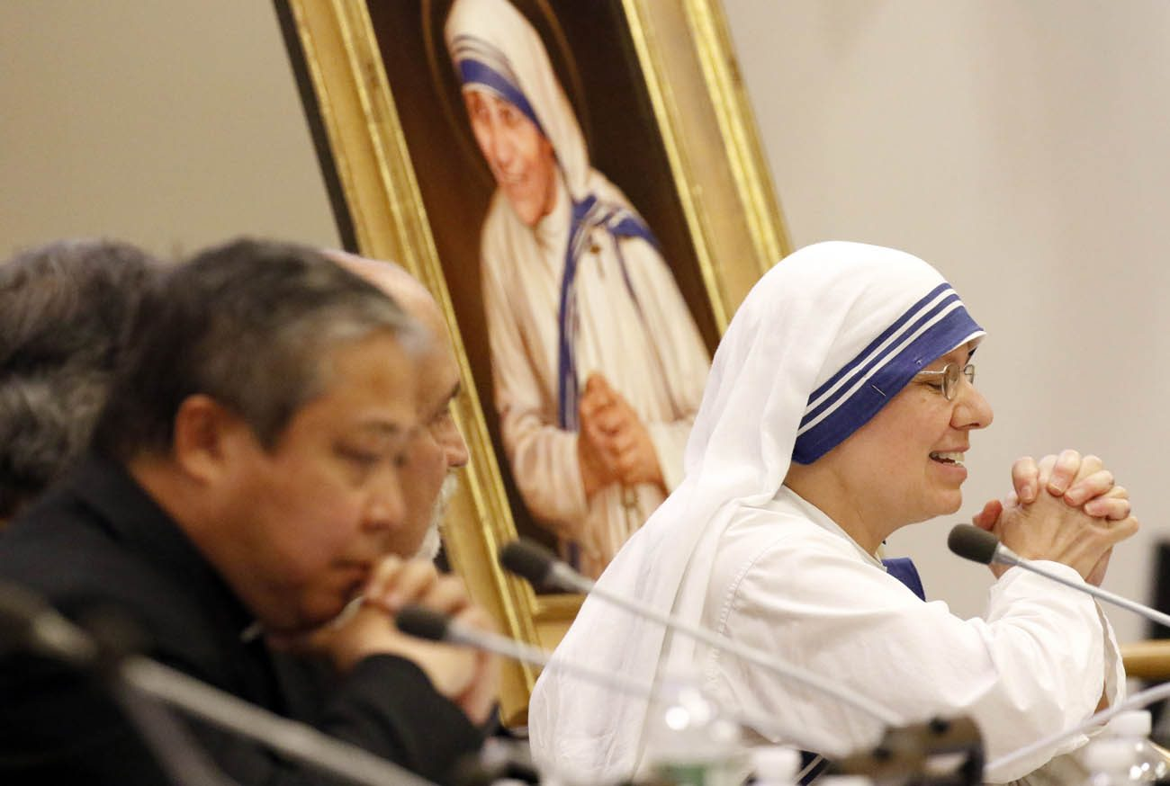 Sister Clare Roy, a member of the Missionaries of Charity, closes her eyes and clasps her hands as she speaks during a conference at the United Nations Sept. 9 on St. Teresa of Kolkata's enduring message to the international community. (CNS photo/Gregory A. Shemitz)