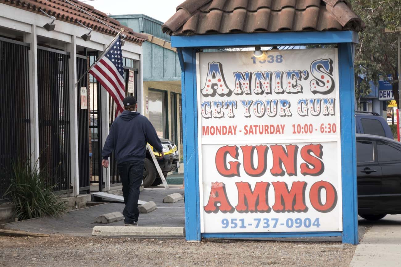 A man walks past a gun store in 2015 in San Bernardino, Calif. Arguments about violence, guns and which kinds of arms should be available to the public long have been a staple in modern-day presidential elections, and this year it's no different. (CNS photo/eugene Garcia, EPA)