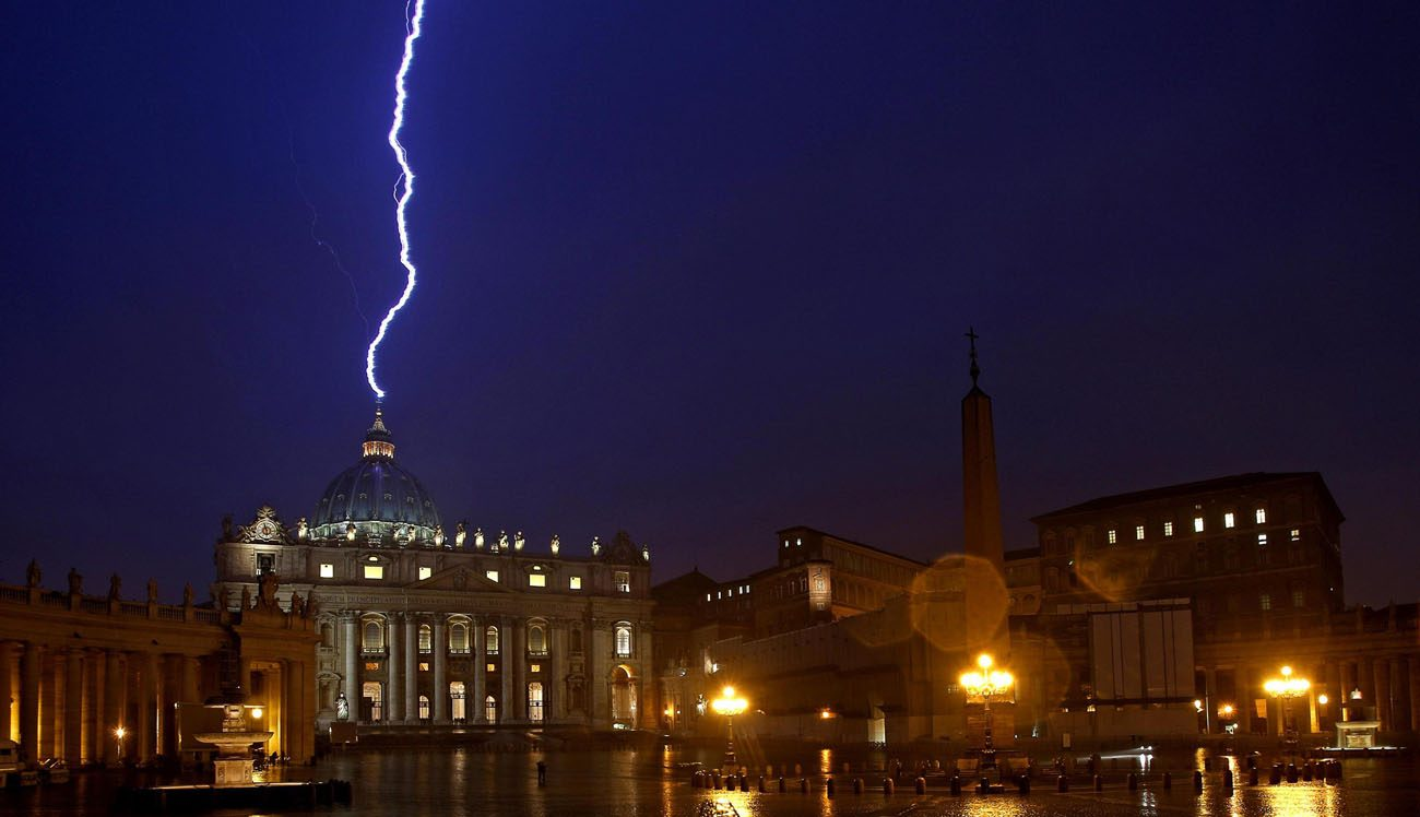 Lighting strikes the dome of St. Peter's Basilica in this Feb. 11, 2013 file photo. The Holy See has adhered to the U.N. Convention Against Corruption, an international treaty focused on preventing, outlawing and prosecuting corruption within nations and internationally. (CNS photo/Alessandro Di Meo, EPA)