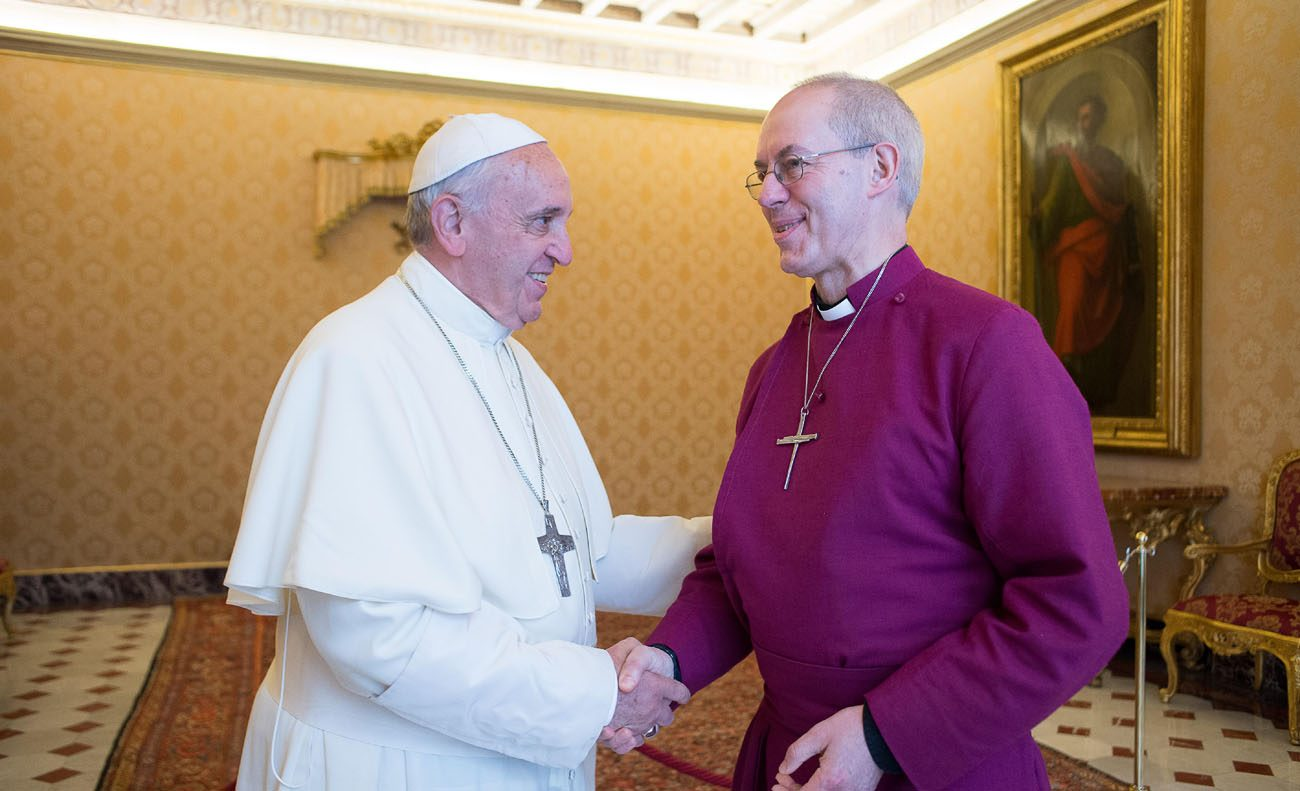 Pope Francis greets Anglican Archbishop Justin Welby of Canterbury, England, spiritual leader of the Anglican Communion, during a private meeting at the Vatican in this June 16, 2014, file photo. The pope will meet Archbishop Welby in Assisi during an interfaith peace meeting this month and in Rome in October. (CNS photo/L'Osservatore Romano)