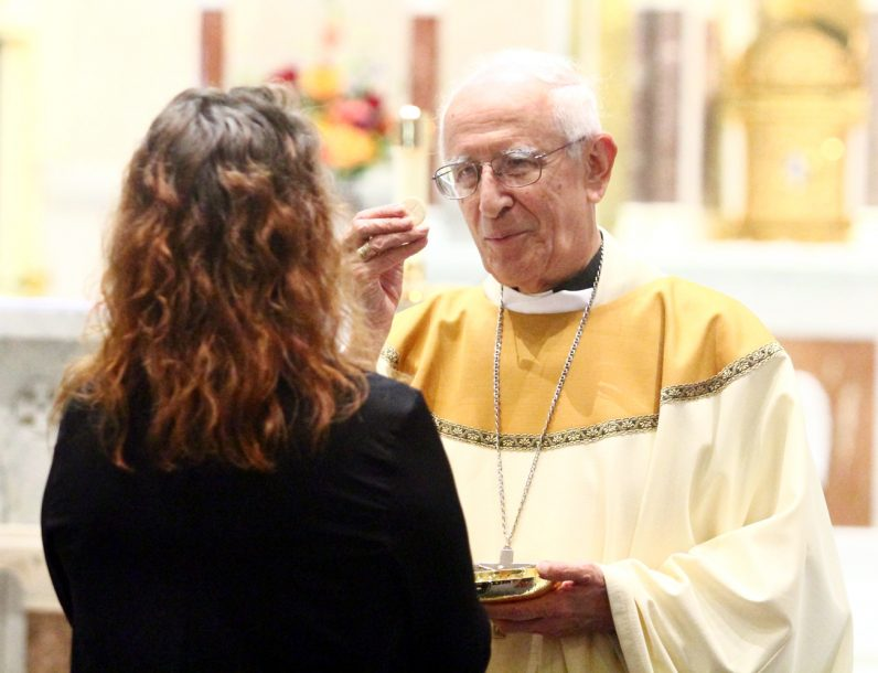 Bishop Cabezas distributes holy Communion.