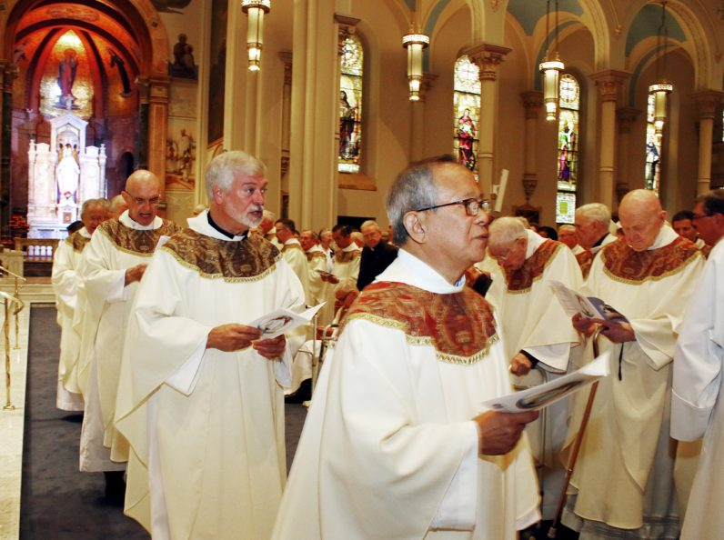 Vincentian priests process into the Miraculous Medal Shrine in Germantown Sept. 24 for a Mass observing their order's 200 years of service in the United States.