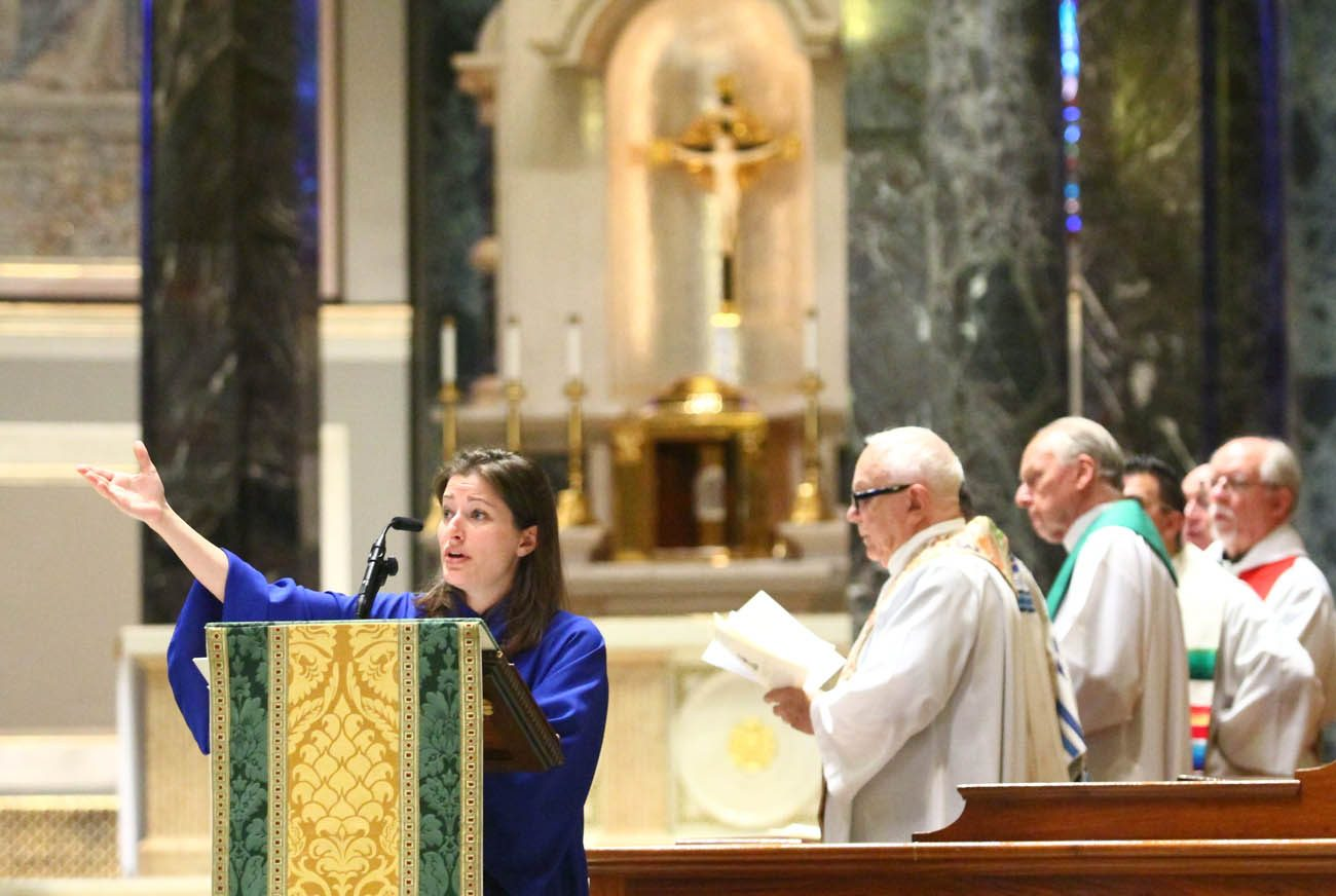 Charlene Angelini leads the congregation in song at the Cathedral Basilica of SS. Peter and Paul in Philadelphia, where she is now director of the Cathedral Music Program. (Sarah Webb)