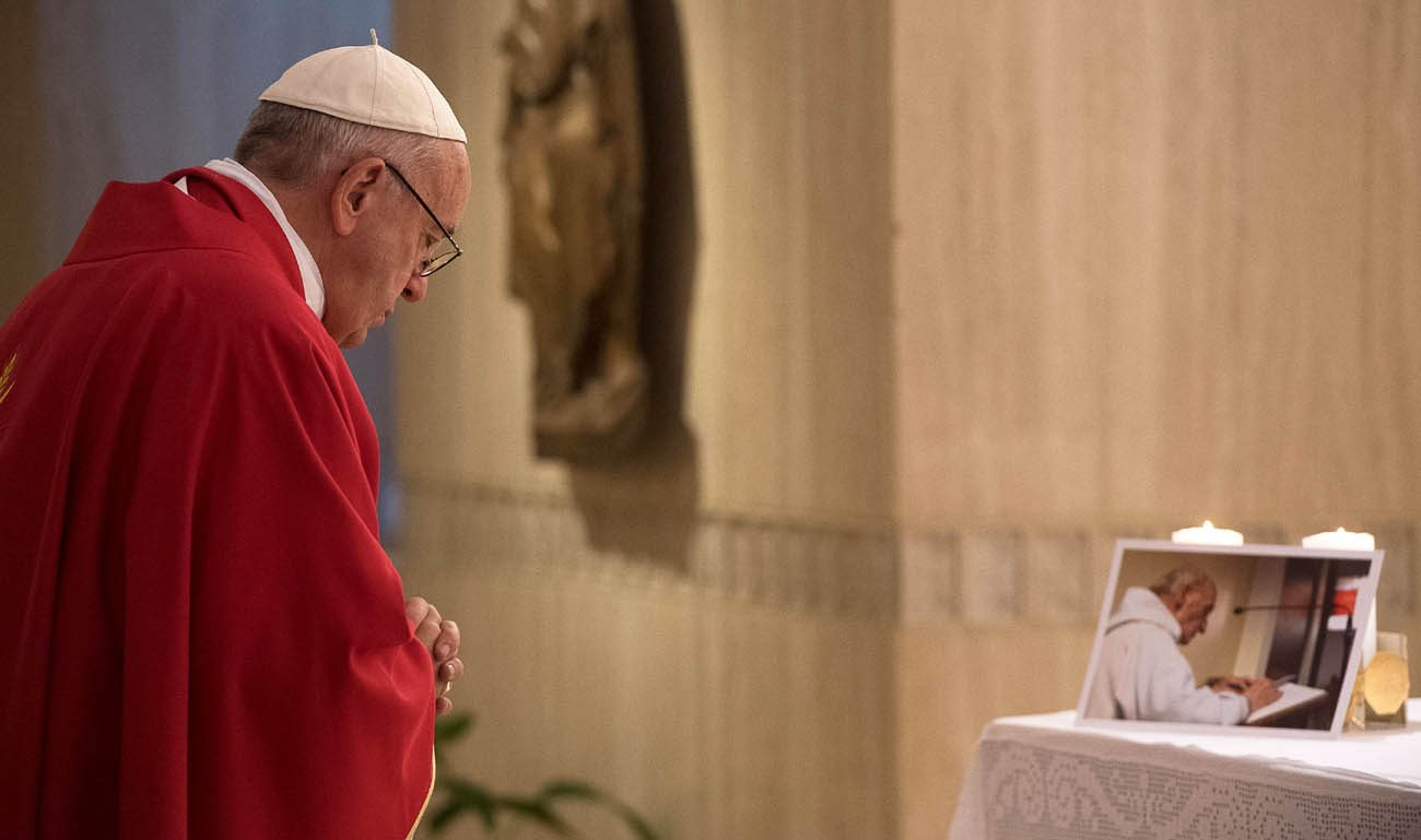 Pope Francis celebrates a memorial Mass for Father Jacques Hamel in the chapel of the Domus Sanctae Marthae at the Vatican Sept. 14. Father Hamel, seen in the photo on the altar, was murdered while celebrating Mass in Rouen, France, July 26; the two killers  claimed allegiance to the Islamic State group. (CNS photo/L'Osservatore Romano)