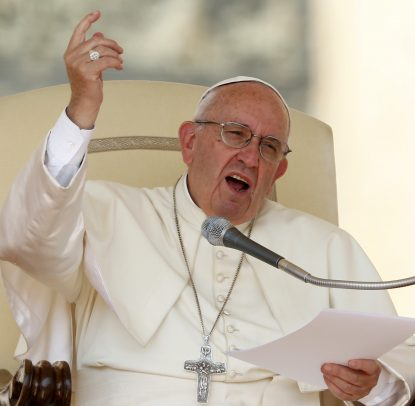 Pope Francis speaks during his general audience in St. Peter's Square at the Vatican Sept. 14. (CNS photo/Paul Haring)