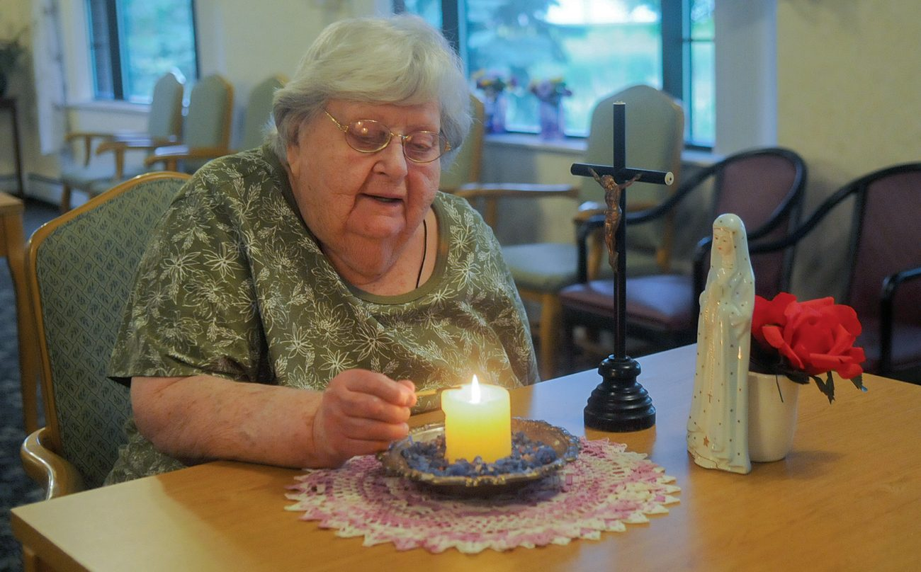 Agnes Imdieke of Albany, Minn., pictured Sept. 6, has been lighting a candle for Jacob Wetterling every morning since he disappeared in October 1989. A Minnesota man confessed to kidnapping and killing the boy Sept. 6. (CNS photo/Dianne Towalski, The Visitor)