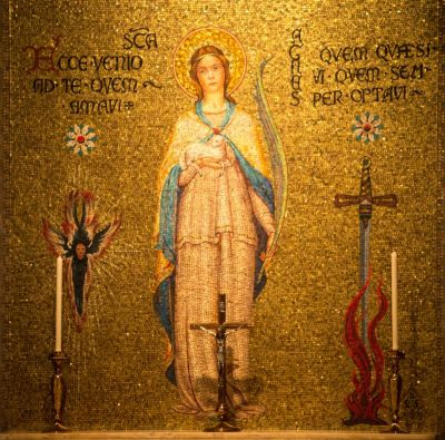 A mosaic of Agnes, a martyr and one of the Mothers of the Church, adorns a chapel wall in the Basilica of the National Shrine of the Immaculate Conception in Washington, in this Sept. 28 photo. Women in the early church did not generally leave behind doctrinal writings. But their lives had such a powerful impact that their stories were written, recited and sung from their day down to ours. (CNS photo/Chaz Muth)