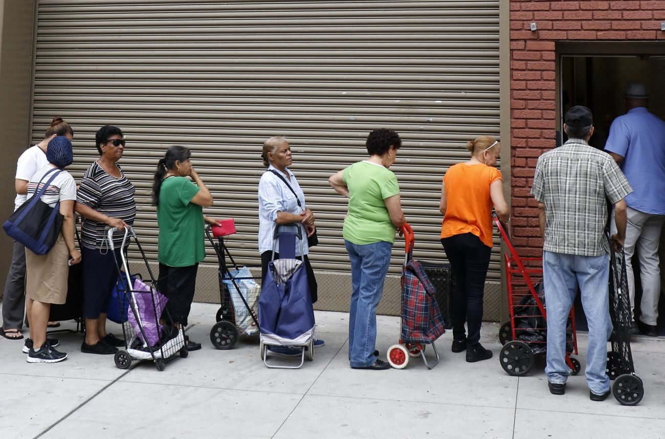 People wait to enter a food pantry at Catholic Charities of the Archdiocese of New York's community center in the South Bronx. (CNS photo/Gregory A. Shemitz)