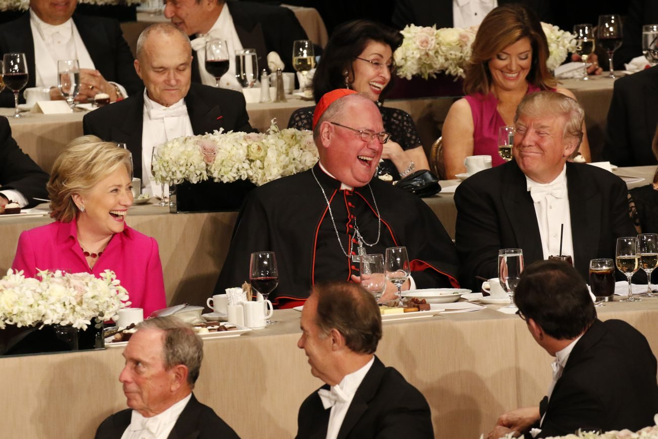 New York Cardinal Timothy M. Dolan shares a light moment with U.S. Democratic presidential nominee Hillary Clinton and Republican presidential nominee Donald Trump during the 71st annual Alfred E. Smith Memorial Foundation Dinner at the Waldorf Astoria hotel in New York City Oct. 20. The charity gala, which honors the memory of the former New York Democratic governor who was the first Catholic nominated by a major political party for the U.S. presidency, raises money to support not-for-profit organizations that serve children in need. (CNS photo/Gregory A. Shemitz)
