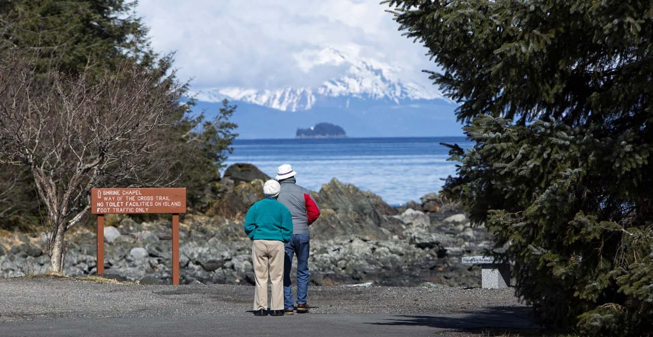 Visitors look out over the water in 2014 at the Shrine of St. Therese in Juneau, Alaska. The place of retreat with breathtaking views was designated a national shrine by the U.S. bishops Oct. 1. (CNS photo/Nancy Wiechec)