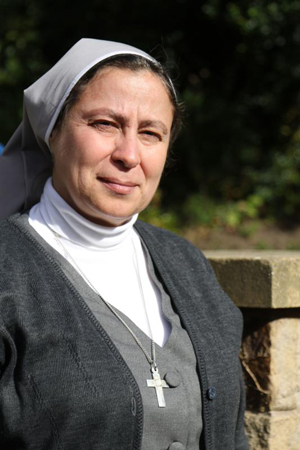 Sister Annie Demerjian, a member of the Sisters of Jesus and Mary who is working with Christian families in Aleppo, Syria, poses for a photo Oct. 10 in Lancaster, England. (CNS photo/Simon Caldwell)