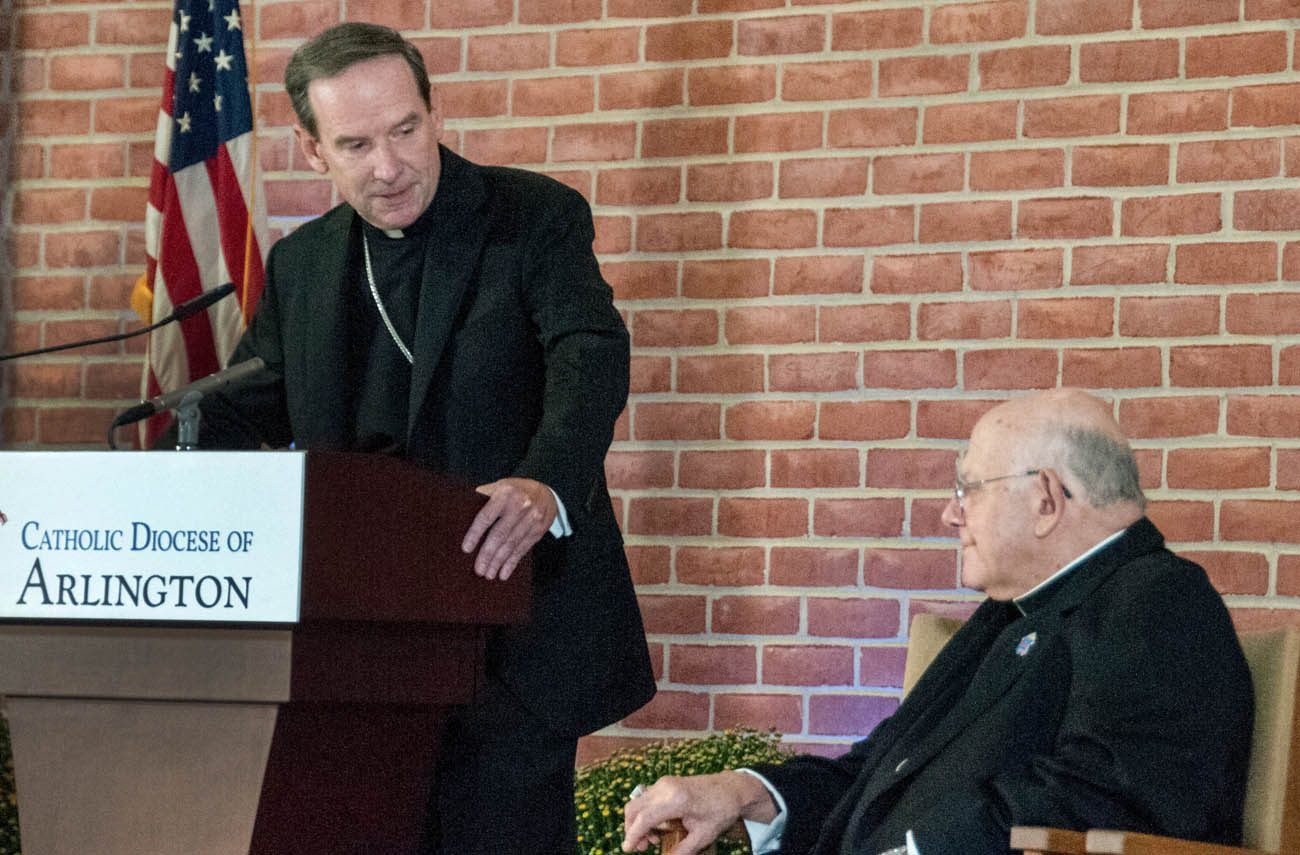 Bishop Michael F. Burbidge of Raleigh, N.C., speaks at an Oct. 4 news conference announcing his appointment as the fourth bishop of the Diocese of Arlington, Va., succeeding Bishop Paul S. Loverde, right. (CNS photo/Ashleigh Buyers, Arlington Catholic Herald)