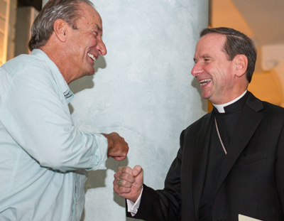 Fran Burbidge bumps fists with his brother, Bishop Michael F. Burbidge of Raleigh, N.C., following an Oct. 4 news conference announcing Bishop Burbidge's appointment as the fourth bishop of the Diocese of Arlington, Va. (CNS photo/Ashleigh Buyers, Arlington Catholic Herald)