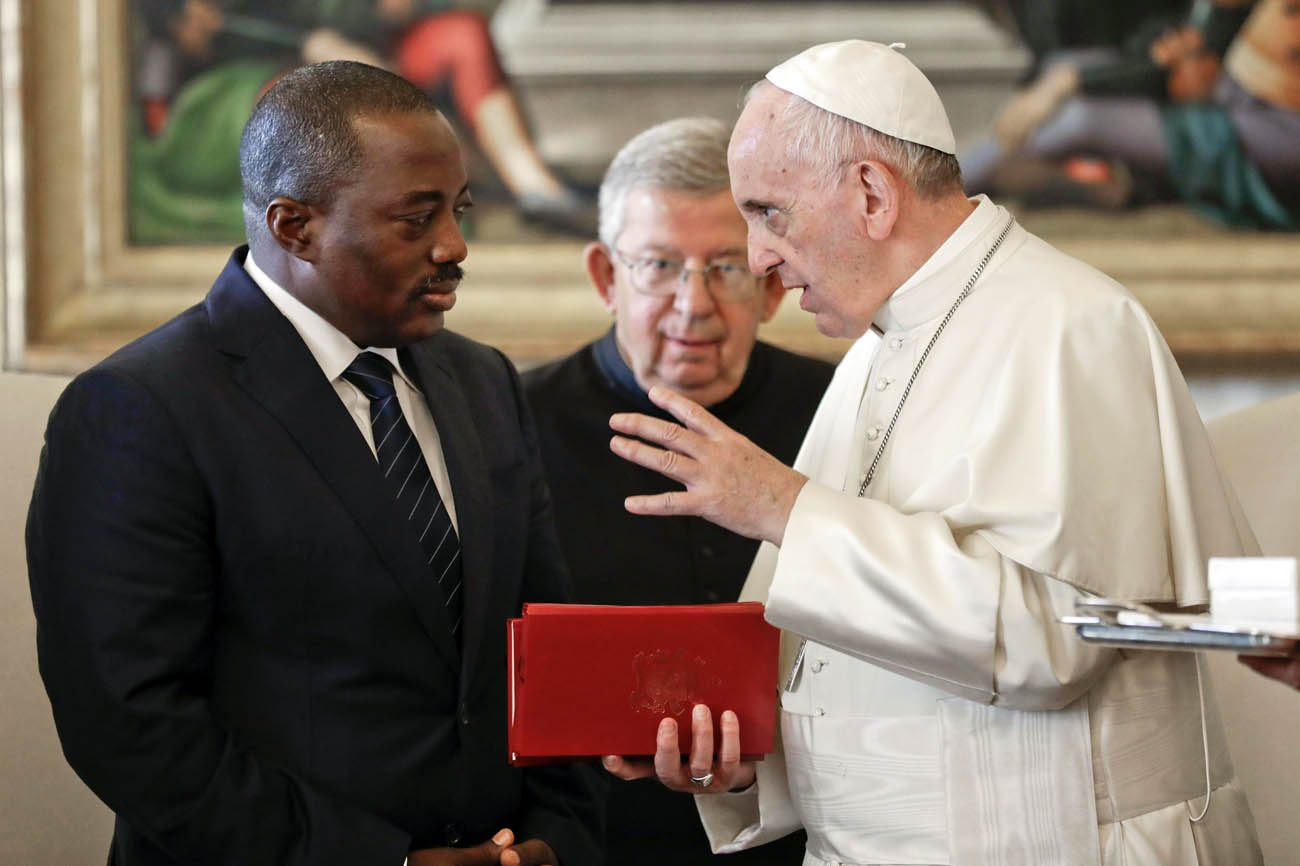 Pope Francis talks with Congolese President Joseph Kabila during a private audience at the Vatican Sept. 26. The Catholic church has pulled out of a national dialogue in Congo, after its president backed the postponement of elections a week after meeting the pope. (CNS photo/Andrew Medichini, pool via Reuters)