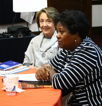 Two women discuss parish initiatives in the Parish Ambassador Corps program of Catholic Relief Services. (Sarah Webb)