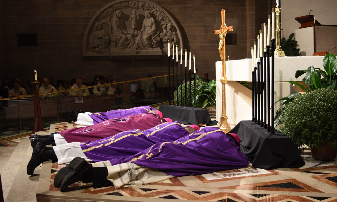 Detroit Archbishop Allen H. Vigneron and Detroit Auxiliary Bishops Michael J. Byrnes, Arturo Cepeda and Donald F. Hanchon lie prostrate before the altar Oct. 7 at the Cathedral of the Most Blessed Sacrament in Detroit as the Litany of Pardon is read aloud. (CNS photo/Dan Meloy, The Michigan Catholic)