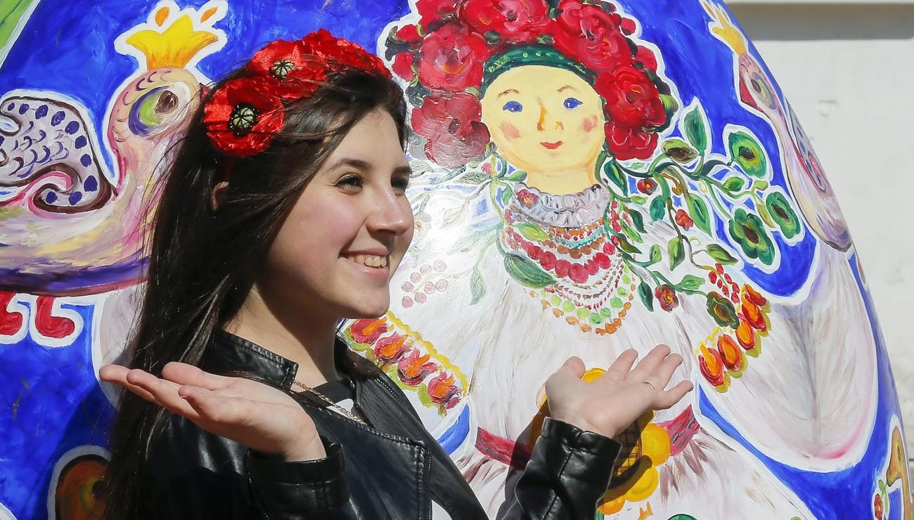 A Ukrainian girl is seen during an Easter celebration outside St. Sophia's Cathedral in Kiev, Ukraine, April 10, 2015. Eastern Catholic migrants living in Western Europe help the Catholic Church become more aware of its universality and diversity and, by remaining active in their faith, can help with the new evangelization of the continent, Eastern Catholic bishops said.(CNS photo/Sergey Dolzhenko, EPA)